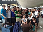 Students arrive at Dulles airport for a three-week program.