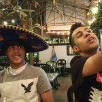 Omar celebrates his 20th birthday at favorite Mexican restaurant as his friend, Faris, takes a selfie.