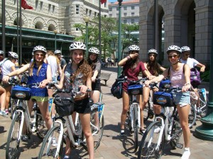 A combined group of teens from Spain and Italy enjoy a bike ride in Washington DC.