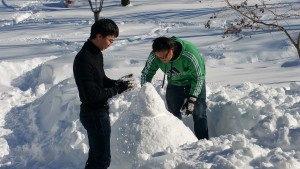 Ryosuke and Chunyi build their very first snowman or snowchicken as it turned out.